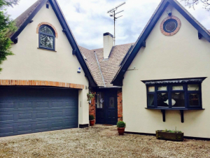 Front of House with Blue Black Painted uPVC Windows, Door and Garage