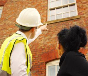 Builder Pointing towards uPVC window