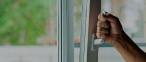 Man opening uPVC Window